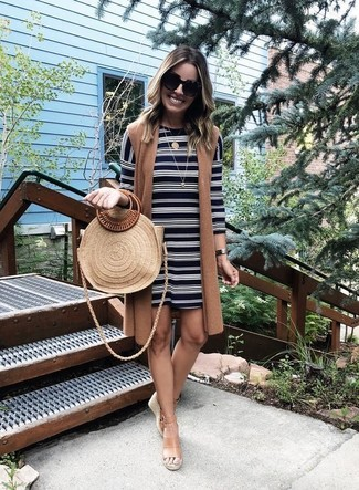 How to wear: tan straw tote bag, tan leather wedge sandals, black and white horizontal striped shift dress, brown sleeveless coat