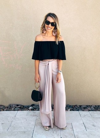 How to Wear a Black Leather Handbag: For an edgy and casual ensemble, pair a black off shoulder top with a black leather handbag — these two items go perfectly well together. To introduce a little oomph to this getup, complement this look with a pair of black canvas wedge sandals.