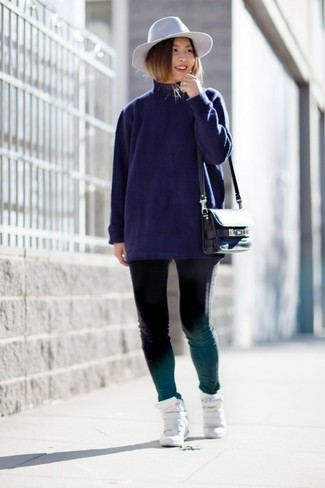 How to wear: black leather crossbody bag, white leather wedge sneakers, black skinny jeans, navy turtleneck