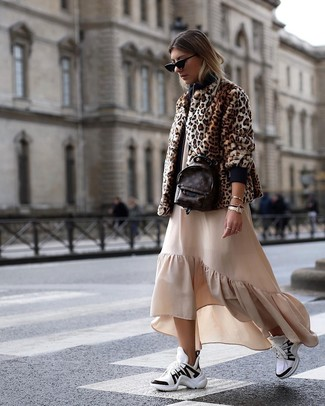 How to wear: dark brown leather backpack, white and black athletic shoes, beige ruffle maxi dress, brown leopard fur jacket