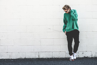 How to wear: white and black athletic shoes, black sweatpants, green knit oversized sweater