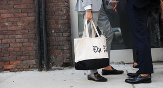 How to wear: white and black print canvas tote bag, black leather loafers, grey suit