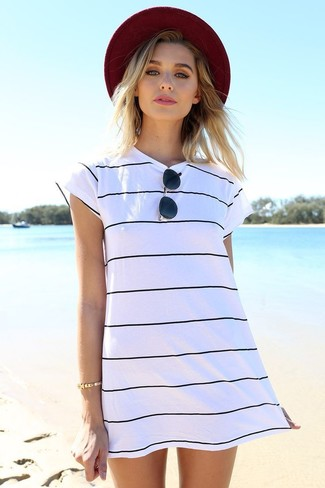 How to wear: white and black horizontal striped casual dress, burgundy hat, black sunglasses, gold bracelet
