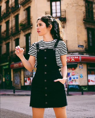 How to Wear a White and Black Horizontal Striped Crew-neck T-shirt For Women: For a relaxed casual ensemble, pair a white and black horizontal striped crew-neck t-shirt with a black denim overall dress — these items play brilliantly together.