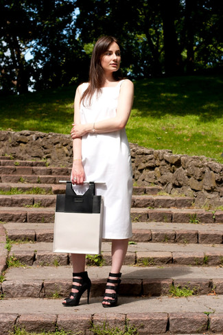 How to wear: white and black leather tote bag, black leather gladiator sandals, white midi dress