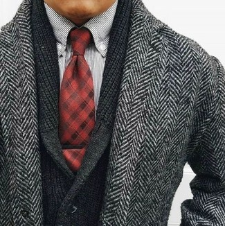 How to wear: red plaid tie, white and black vertical striped long sleeve shirt, black shawl cardigan, grey herringbone overcoat