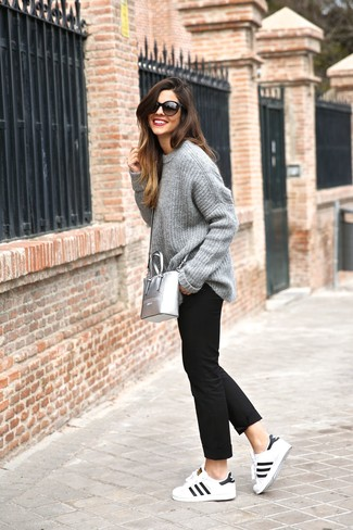 How to wear: silver leather crossbody bag, white and black leather low top sneakers, black chinos, grey knit oversized sweater