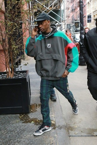 How to wear: black baseball cap, white and black leather low top sneakers, navy and green plaid chinos, multi colored horizontal striped hoodie