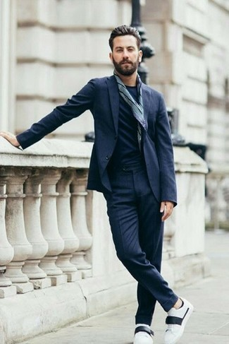 How to Wear White and Black Leather Low Top Sneakers For Men: This pairing of a navy suit and a navy crew-neck t-shirt is hard proof that a simple outfit doesn't have to be boring. Bring an element of stylish effortlessness to by rocking white and black leather low top sneakers.