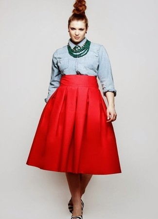 How to Wear a Light Blue Denim Shirt For Women: Effortlessly blurring the line between elegant and laid-back, this pairing of a light blue denim shirt and a red full skirt will easily become your go-to. For something more on the sophisticated side to complement this ensemble, add white and black horizontal striped calf hair pumps to the mix.
