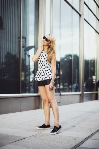 Nail glam in a monochrome polka dot shell top and black leather shorts. Black leather slip-on sneakers will give your look an on-trend feel.
