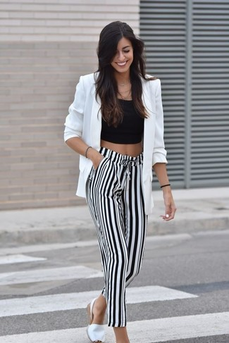 How to wear: white espadrilles, white and black vertical striped wide leg pants, black cropped top, white blazer