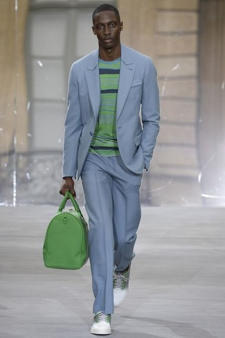 How to wear: green leather holdall, white and green leather low top sneakers, green horizontal striped crew-neck sweater, light blue suit