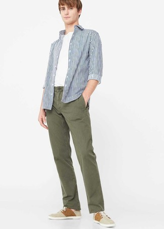 How to wear: white and navy vertical striped long sleeve shirt, white crew-neck t-shirt, olive chinos, beige plimsolls
