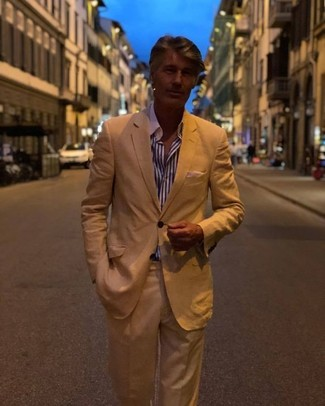 How to wear: white and navy vertical striped dress shirt, tan suit