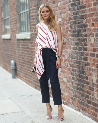 Olivia Palermo wearing White and Red Vertical Striped Sleeveless Top, Black Tapered Pants, Black Leather Heeled Sandals, Black Leather Watch