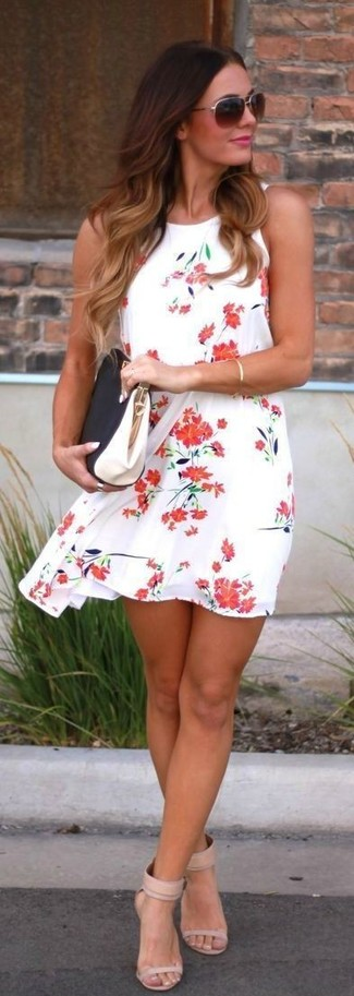 How to wear: white and red floral swing dress, beige leather heeled sandals, black and white leather clutch, dark brown sunglasses
