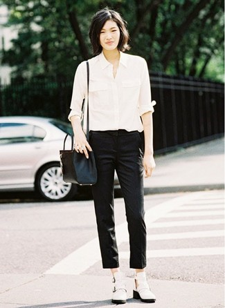How to wear: black leather crossbody bag, white cutout leather ankle boots, black skinny pants, white dress shirt