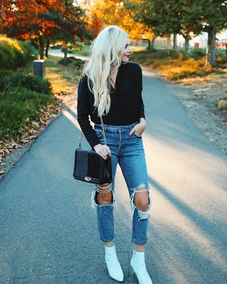 How to wear: black quilted leather satchel bag, white leather ankle boots, blue ripped boyfriend jeans, black v-neck sweater
