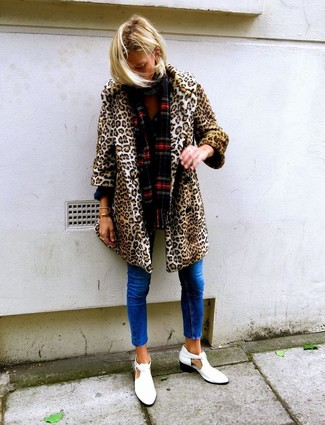 How to wear: red plaid scarf, white cutout leather ankle boots, blue skinny jeans, tan leopard fur coat
