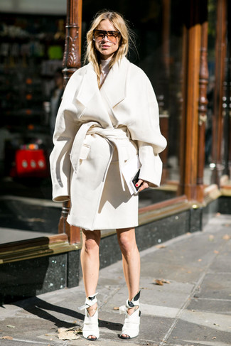 How to wear: brown sunglasses, white cutout leather ankle boots, white turtleneck, white coat