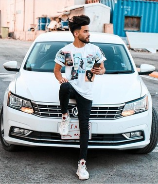 Teen Boy Fashion: What To Wear: A white print crew-neck t-shirt looks especially good when matched with black skinny jeans in a casual menswear style. This look is rounded off perfectly with white athletic shoes.