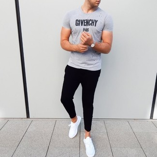 How to wear: silver watch, white athletic shoes, black sweatpants, grey print crew-neck t-shirt