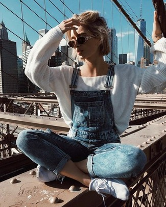 How to wear: dark brown sunglasses, white athletic shoes, blue denim overalls, white oversized sweater