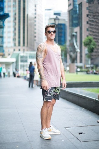 Men's Looks & Outfits: What To Wear In a Relaxed Way: For a casual outfit, dress in a pink tank and charcoal print shorts — these items work nicely together. On the footwear front, this look is rounded off well with white athletic shoes.