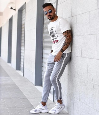 How to wear: navy sunglasses, white athletic shoes, grey chinos, white print crew-neck t-shirt
