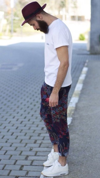 How to Wear Blue Floral Chinos: For an on-trend ensemble without the need to sacrifice on practicality, we love this combination of a white crew-neck t-shirt and blue floral chinos. For something more on the daring side to round off your look, complete this ensemble with white athletic shoes.