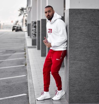 How to wear: white athletic shoes, red sweatpants, white and red print hoodie
