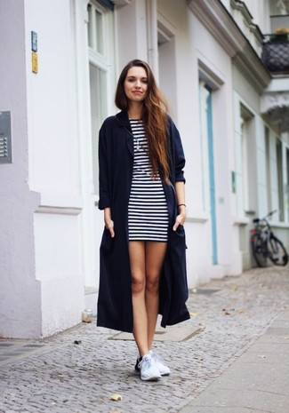How to wear: white athletic shoes, white and navy horizontal striped casual dress, navy duster coat