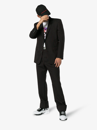 How to wear: black baseball cap, white athletic shoes, white print crew-neck t-shirt, black vertical striped suit