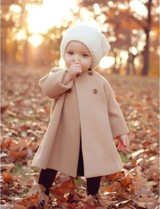 How to wear: white beanie, burgundy leggings, beige coat