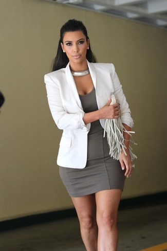 Kim Kardashian wearing White Blazer, Grey Bodycon Dress, White Fringe Leather Clutch, Silver Necklace