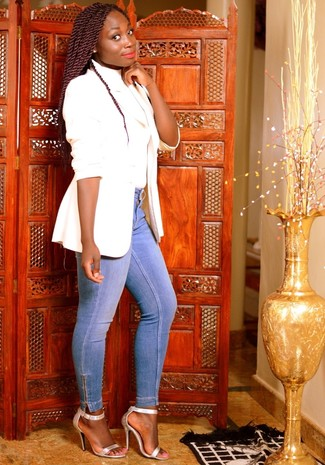 How to wear: white blazer, white turtleneck, light blue skinny jeans, silver leather heeled sandals