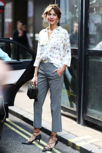 Wear a white print button down blouse and white and black check skinny pants for a casual level of dress. A pair of black lace pumps will seamlessly integrate within a variety of combinations. We love that this outfit is great when spring sets it.