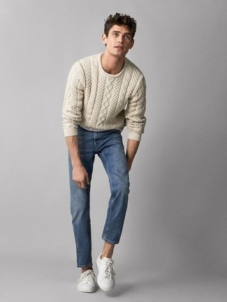 Men's Looks & Outfits: What To Wear In 2020: Team a beige cable sweater with blue jeans for a casual menswear style with a twist. A pair of white canvas low top sneakers looks wonderful finishing your look.