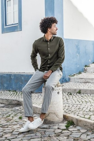How to Wear White Canvas Low Top Sneakers For Men: This casual combo of an olive long sleeve shirt and grey chinos is a tested option when you need to look dapper in a flash. White canvas low top sneakers can instantly play down an all-too-polished outfit.