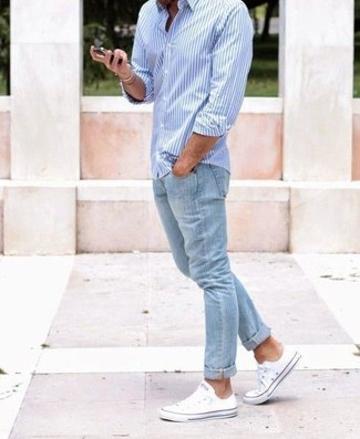How to wear: white canvas low top sneakers, light blue jeans, light blue vertical striped long sleeve shirt