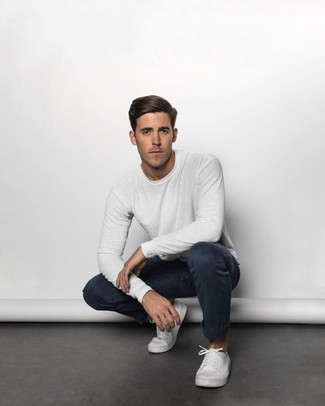 How to wear: white canvas low top sneakers, navy chinos, white long sleeve t-shirt