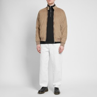 How to wear: black leather derby shoes, white chinos, black zip neck sweater, tan harrington jacket