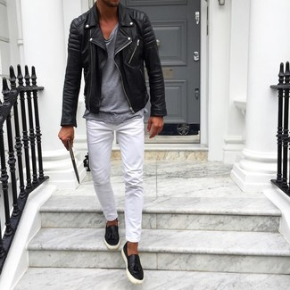 How to wear: black leather slip-on sneakers, white chinos, grey crew-neck t-shirt, black leather biker jacket