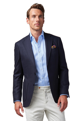 How to wear: multi colored print pocket square, white chinos, light blue dress shirt, navy blazer