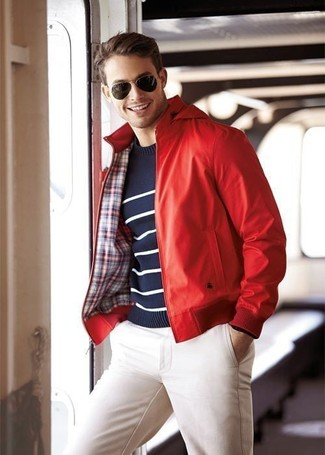 How to wear: dark brown sunglasses, white chinos, navy and white horizontal striped crew-neck sweater, red leather bomber jacket
