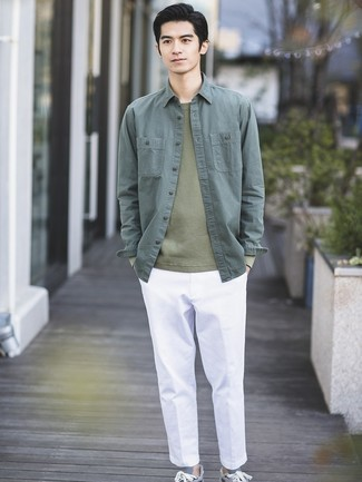 How to wear: grey low top sneakers, white chinos, olive crew-neck sweater, dark green shirt jacket