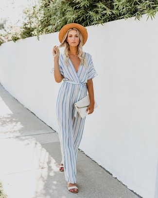 How to wear: khaki straw hat, white leather clutch, white leather flat sandals, light blue vertical striped jumpsuit