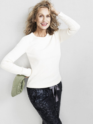 Lauren Hutton wearing White Crew-neck Sweater, Black Sequin Tapered Pants
