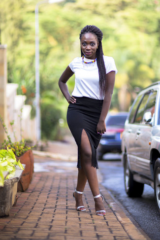 How to wear: white crew-neck t-shirt, black fringe pencil skirt, silver leather heeled sandals, multi colored necklace
